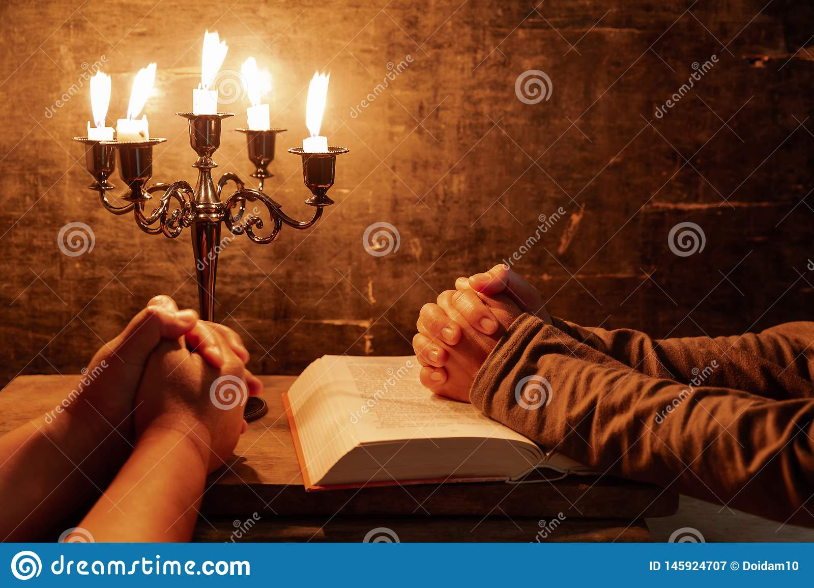 Religious Female Crossed Hands In Prayer With Bible And