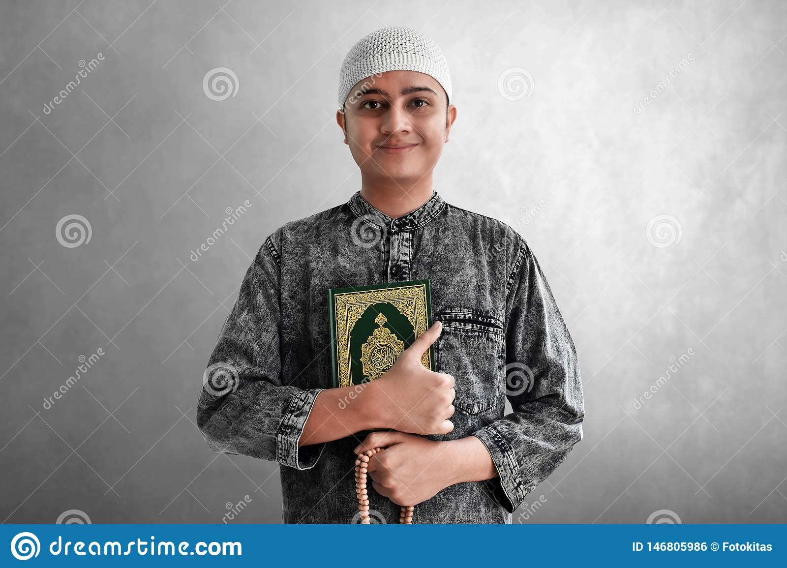 Religious Muslim Man Holding Quran And Rosary Beads Stock