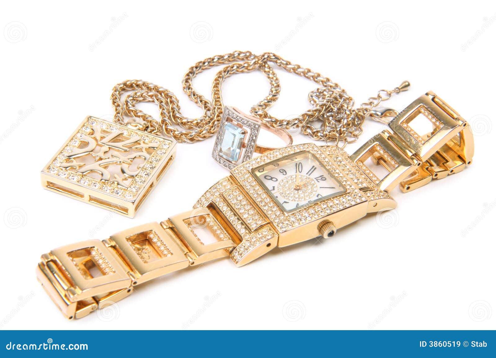 Reloj, anillo y collar de oro.