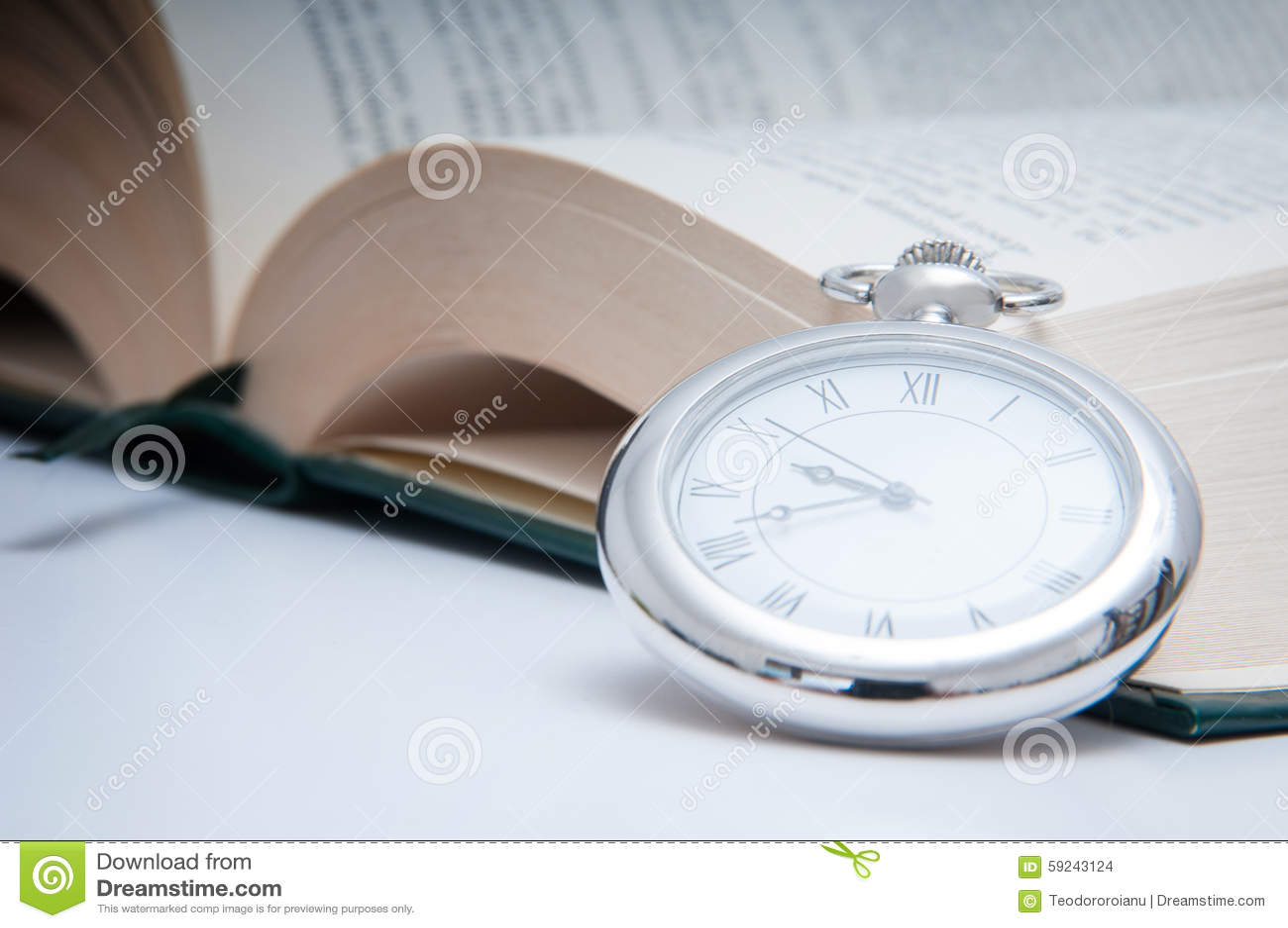 Download Reloj y libro foto de archivo. Imagen de aislante, hospitalidad - 59243124