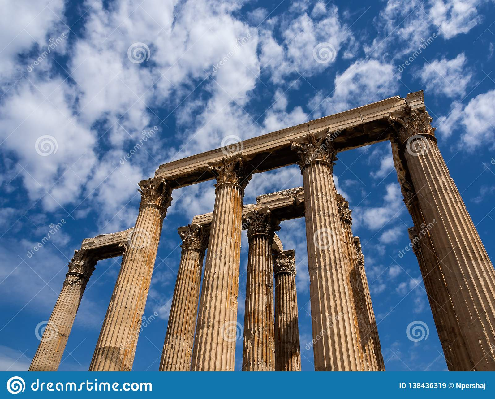 Remaining columns of Temple of Olympian Zeus in Athens, Greece shot against blue sky and picturesque clouds