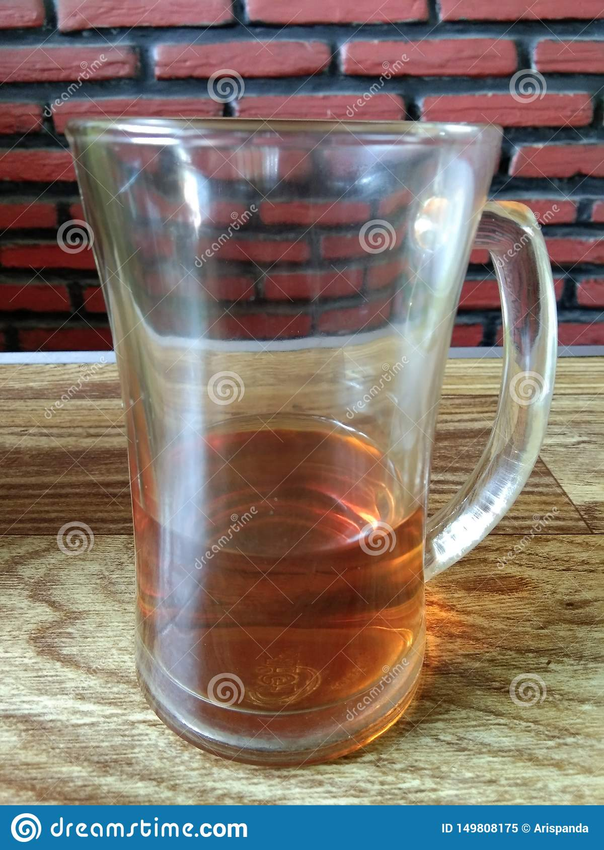 The remaining tea drinks in a glass
