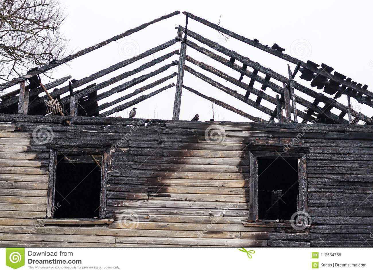 Roof Planks And Windows Remains Of Burnt Wooden House Stock Photo