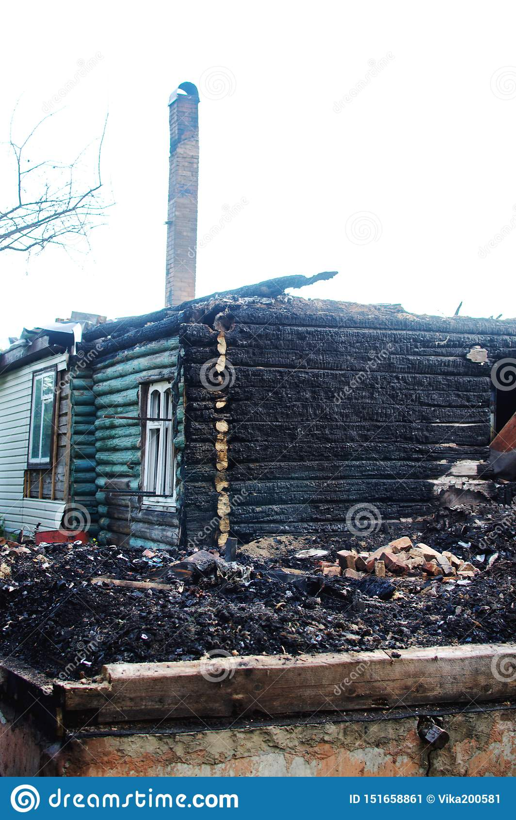 The Remains Of The Wooden House After The Fire Stock Image