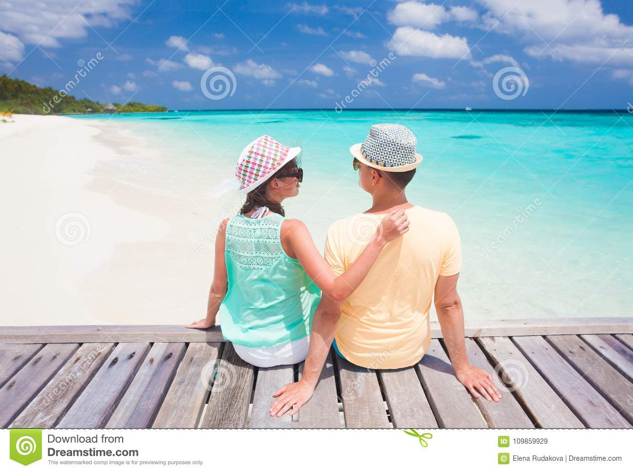 ab729336490 Back View Of Couple Sitting On A Tropical Beach On Maldives Stock ...