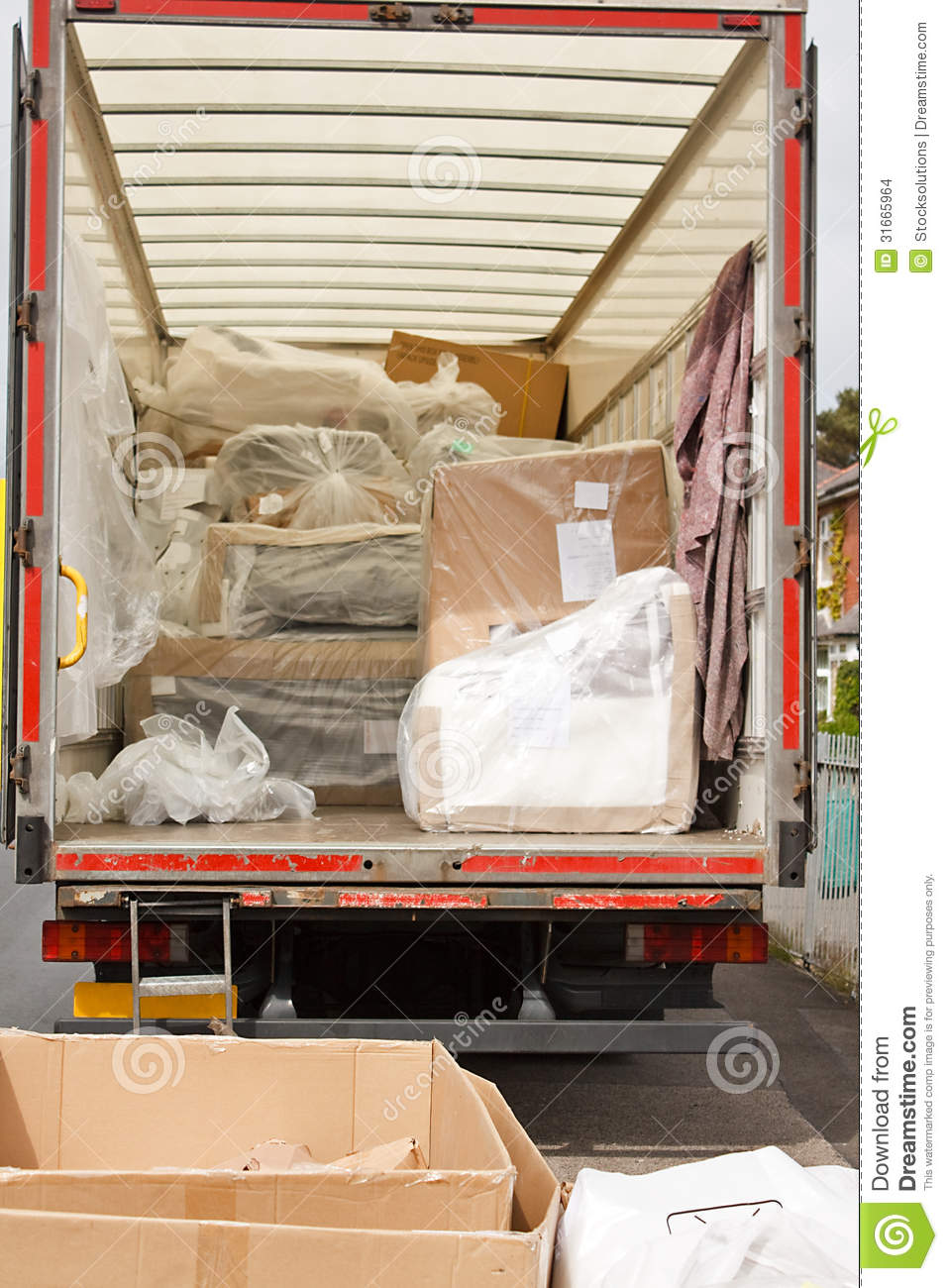 http://thumbs.dreamstime.com/z/removals-van-truck-plastic-wrapped-furniture-loaded-back-moving-house-31665964.jpg