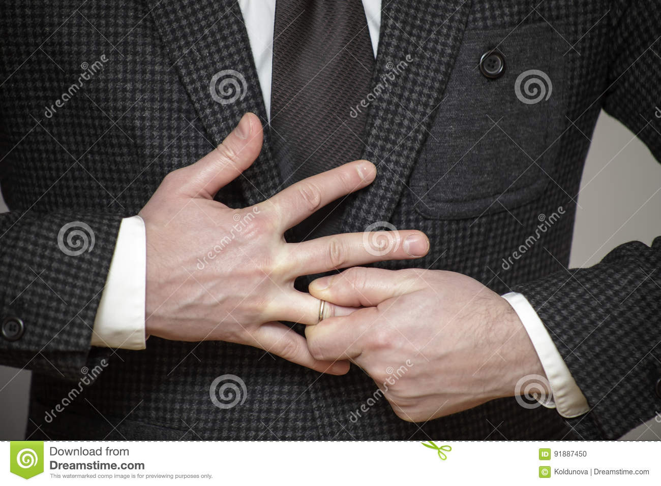 Remove Wedding Ring From His Finger Stock Photo - Image: 91887450