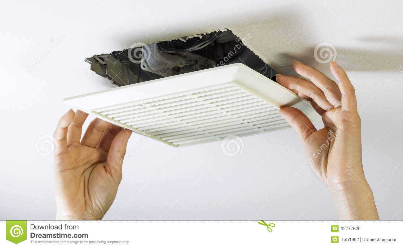 Removing Bathroom Fan Vent Cover To Clean Inside Stock Photo Image - Clean bathroom fan