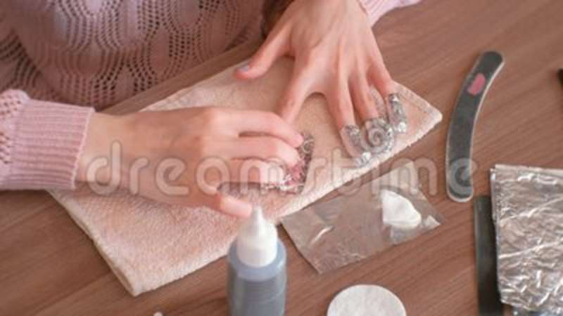 Removing Gel Polish From Nails. Woman Pours Remove Liquid On A ...