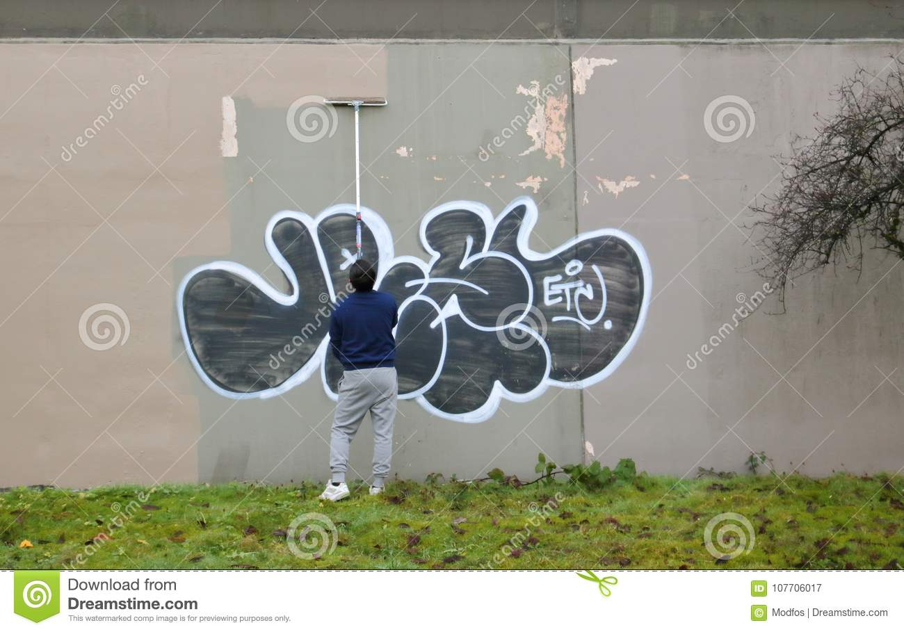 Removing Graffiti From Exterior Wall Editorial Photography   Image ...