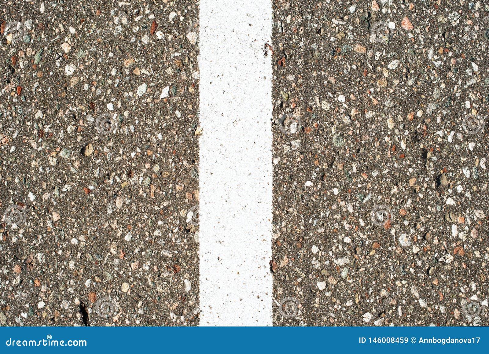 Remsor f?r pilhorisontalmarkeringsv?g Gr? asfalttextur f?r bakgrund