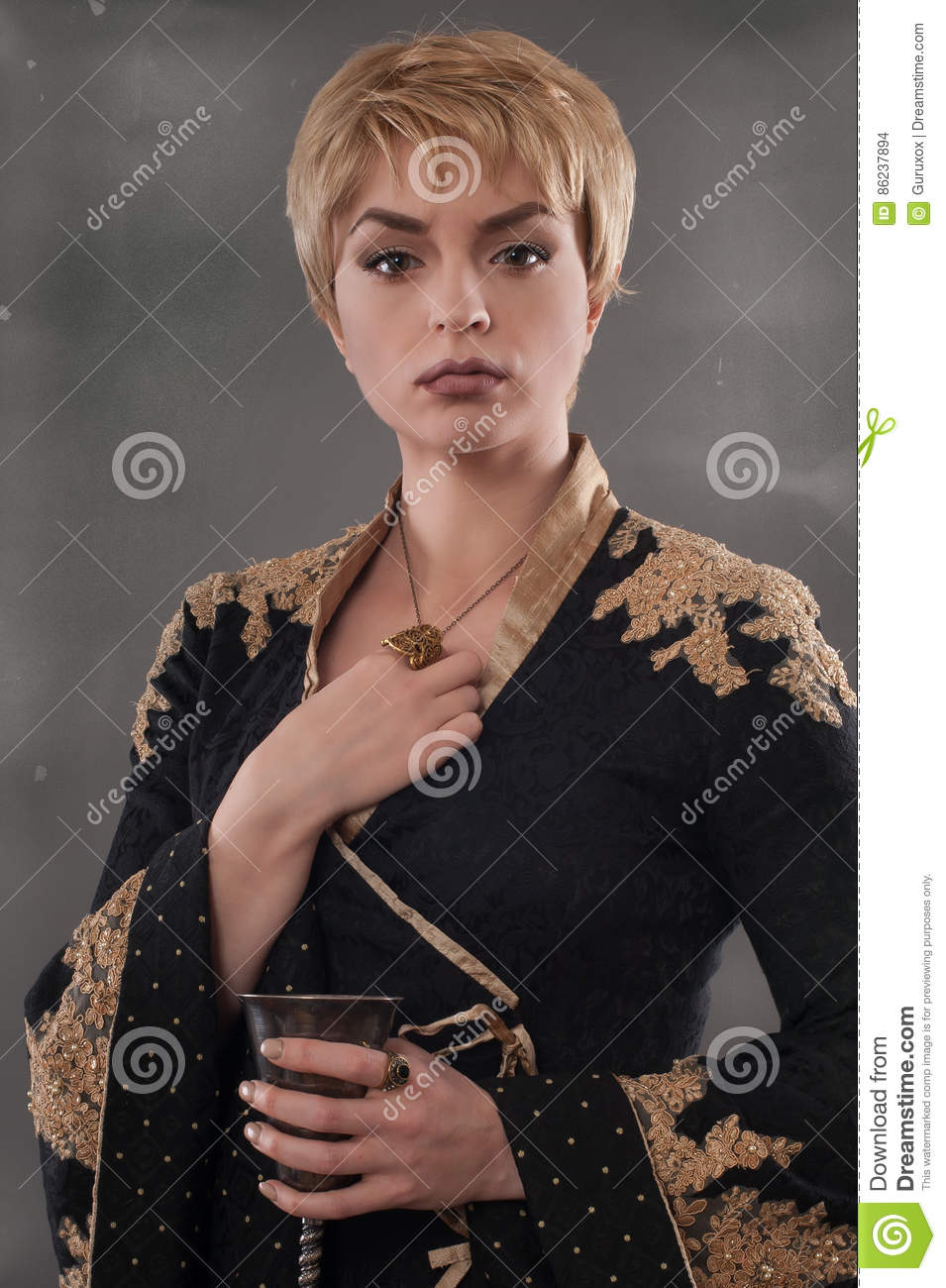 Renaissance Fashion Woman Holding Goblet With Wine Stock