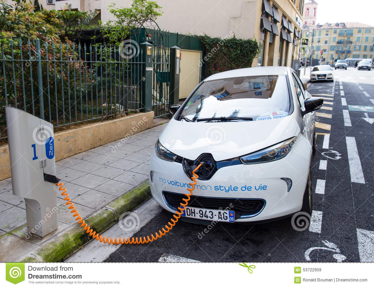 renault zoe electric car connected to a charging station. Black Bedroom Furniture Sets. Home Design Ideas
