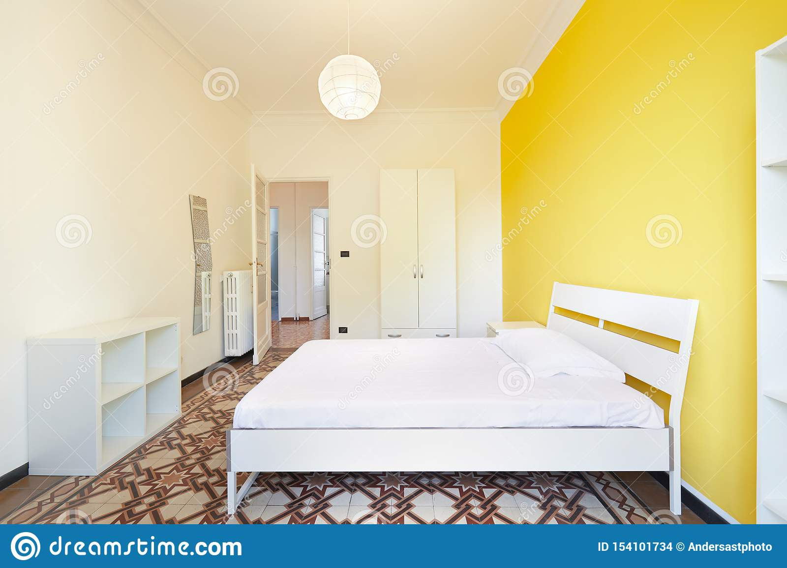 Renovated Bedroom In Apartment For Rent With White And Yellow Walls Stock Photo Image Of Door Floor 154101734