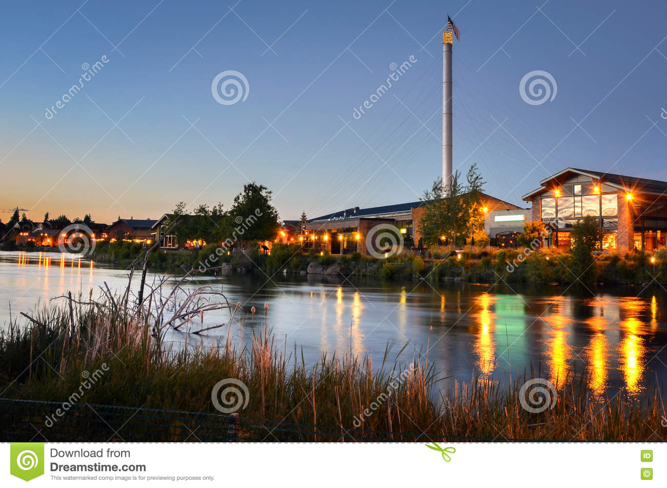 Renovated Buildings alongside a River at Twilight