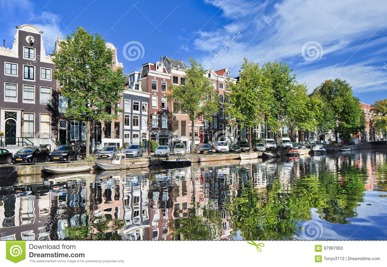 Renovated mansions reflected in a canal, Amsterdam, Netherlands
