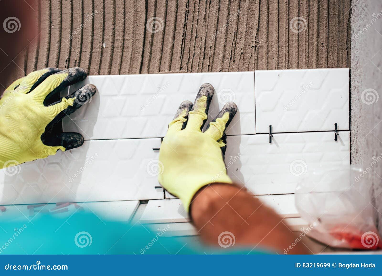 Renovation Close-up Details - Hands Of Worker Installing Ceramic ...