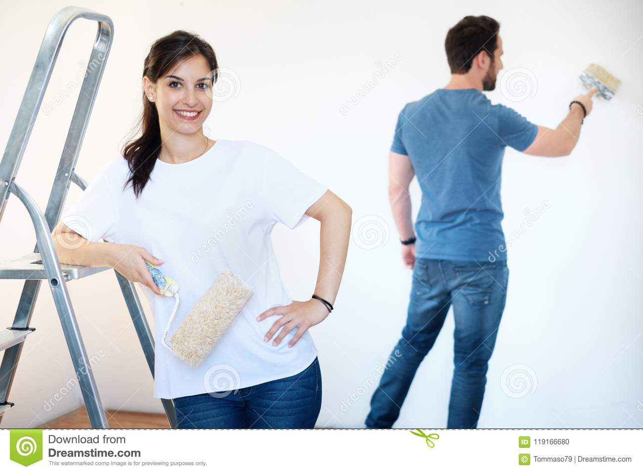 Download Renovation Diy Paint Couple In New Home Painting Wall Together Stock Photo