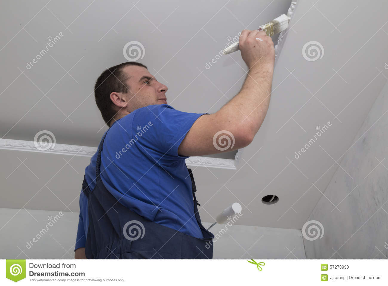 Renovation Of House Interior Man Worker Painting Stock