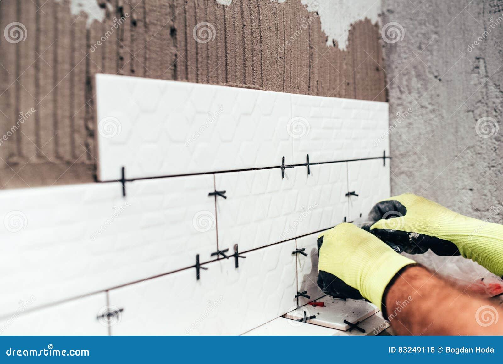 Renovation In Progress. Industrial Worker Installing Bathroom Tiles ...