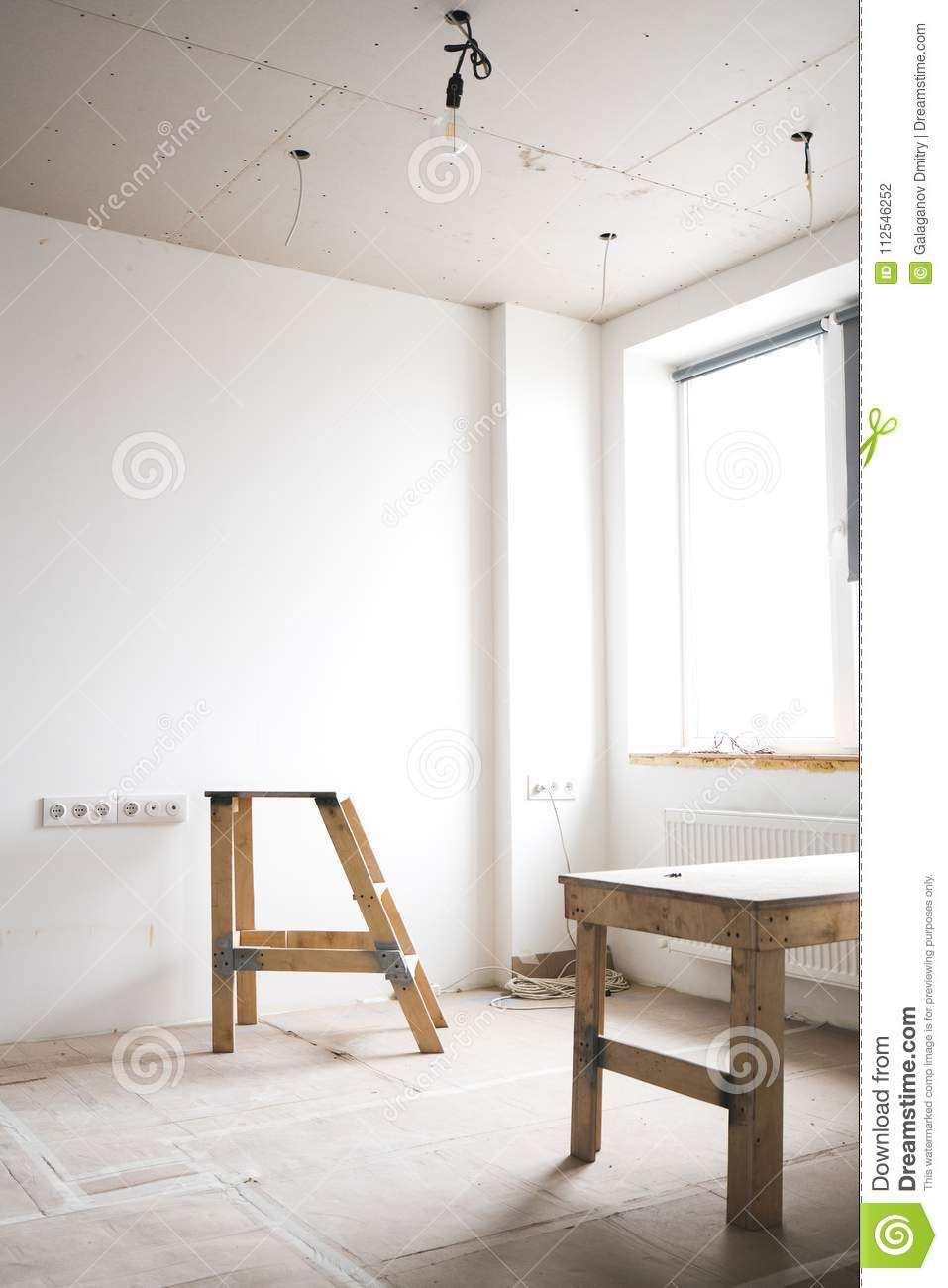 Repair In The Apartment Two Wooden Ladders A White Interior Wiring Behind Plaster Walls Bright Room With Fresh Plastered And Working Electricity House