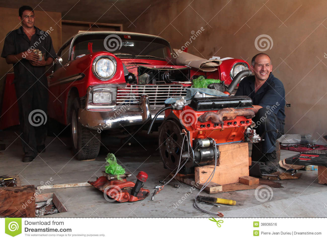 TRINIDAD, CUBA, FEBRUARY 18, 2014 : Men to repair classic old American ...