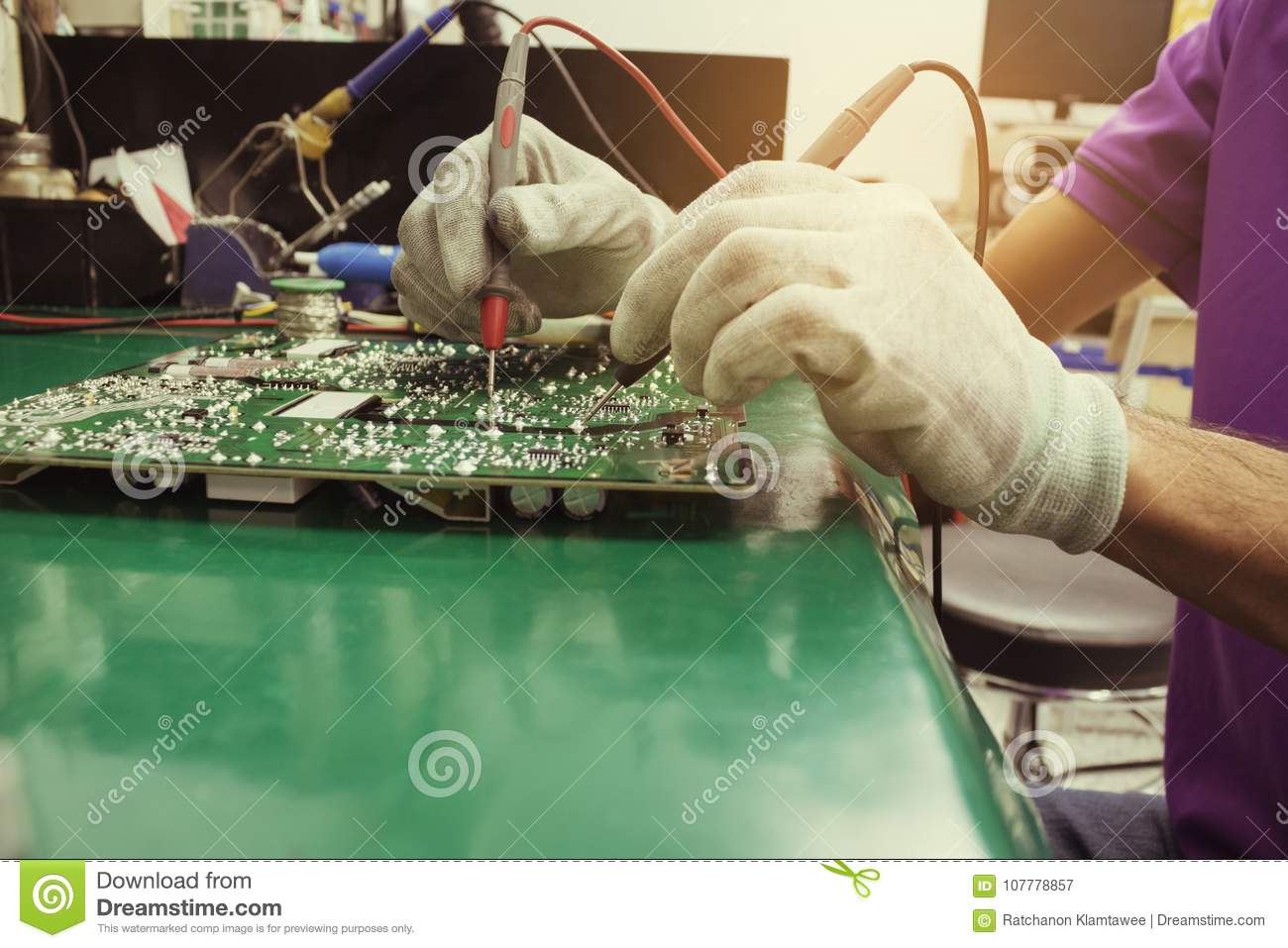 The Repair Man Using Digital Multimeter Measurement On Circuit Of ...