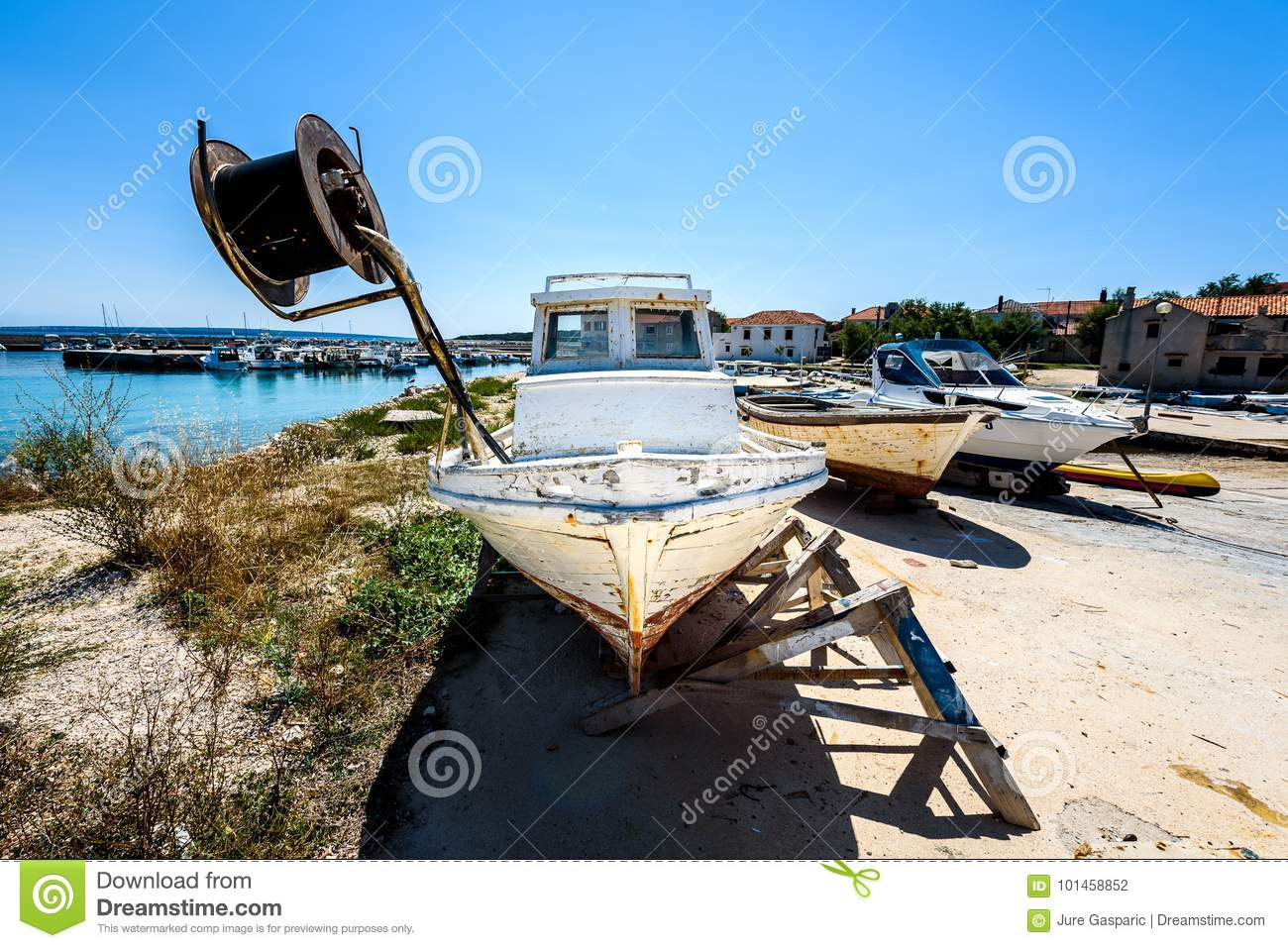 Repair and restoration of old wooden fishing ship or boat.