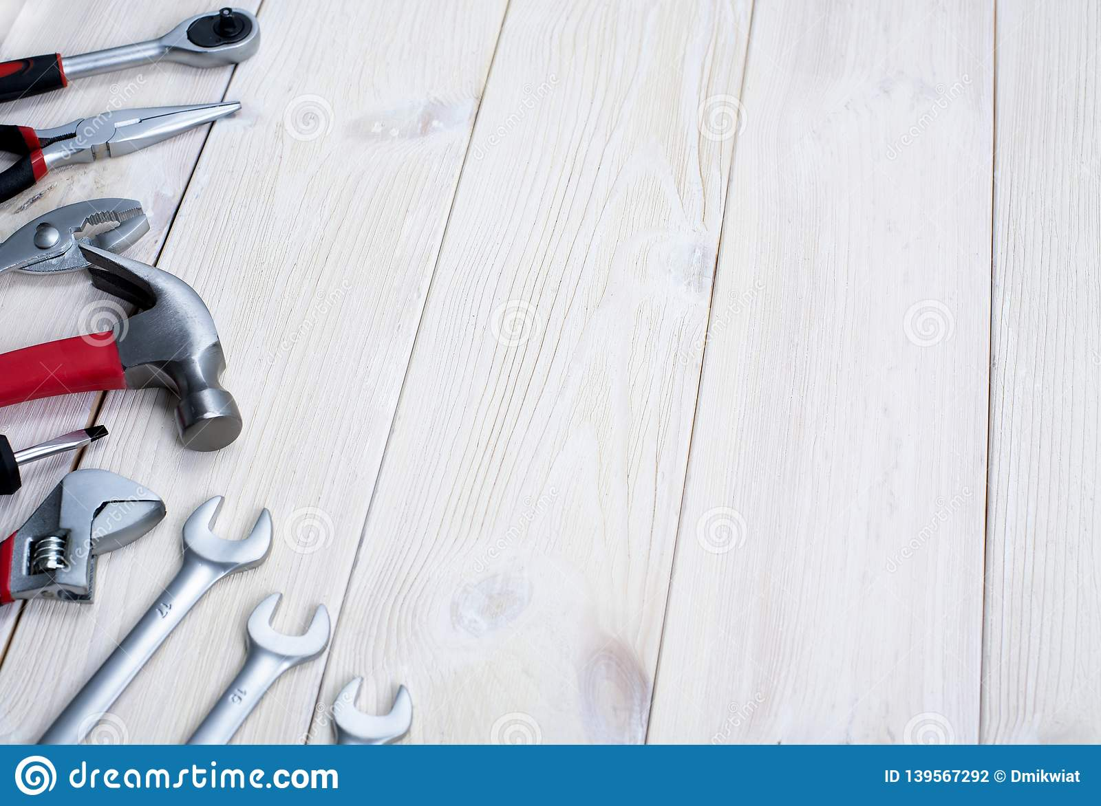 Repair tools on a white wooden background. Jack keys and hammer. Space for text