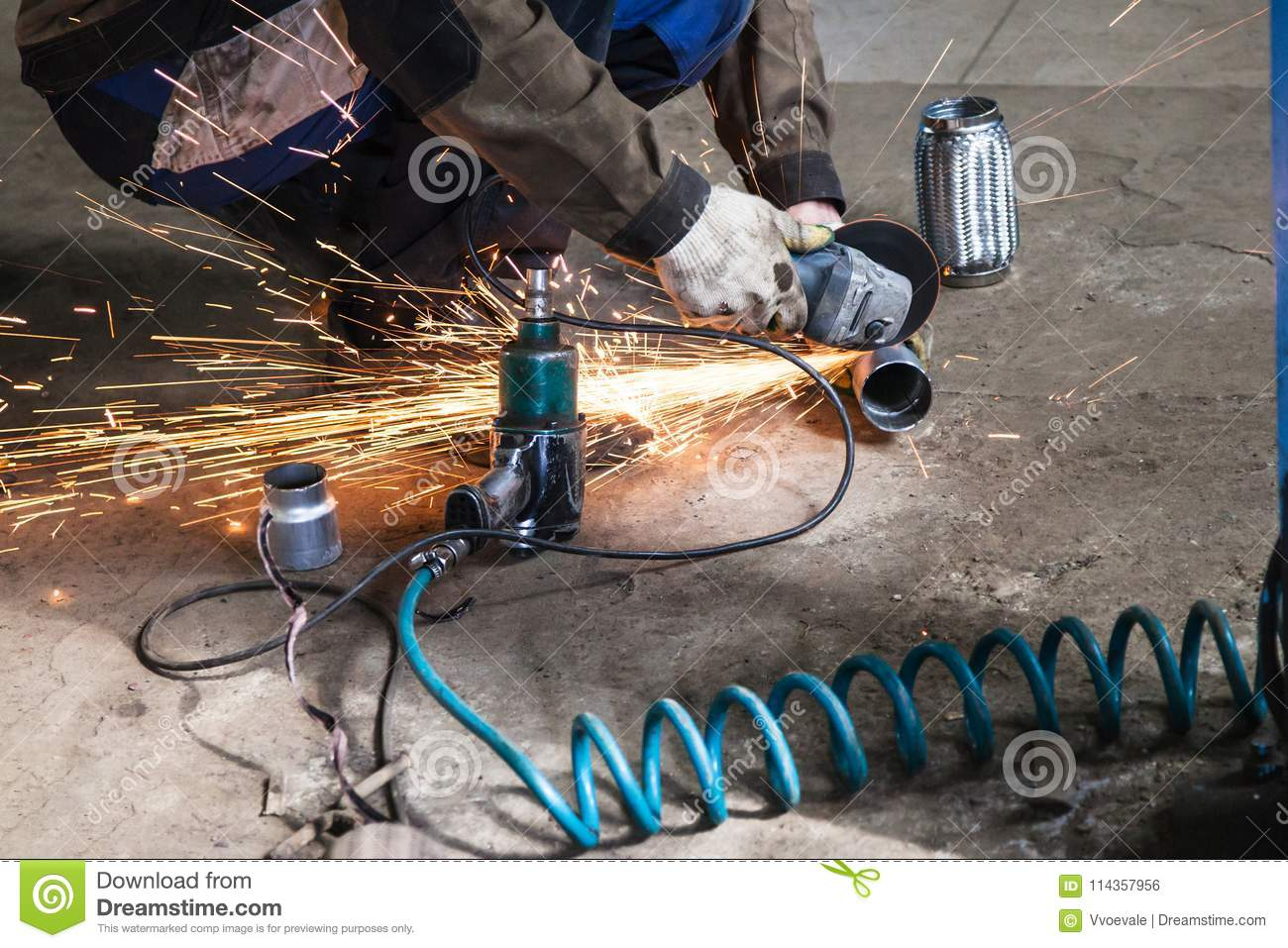 Mechanic Cuts New Pipe For Corrugation Silence Stock Photo