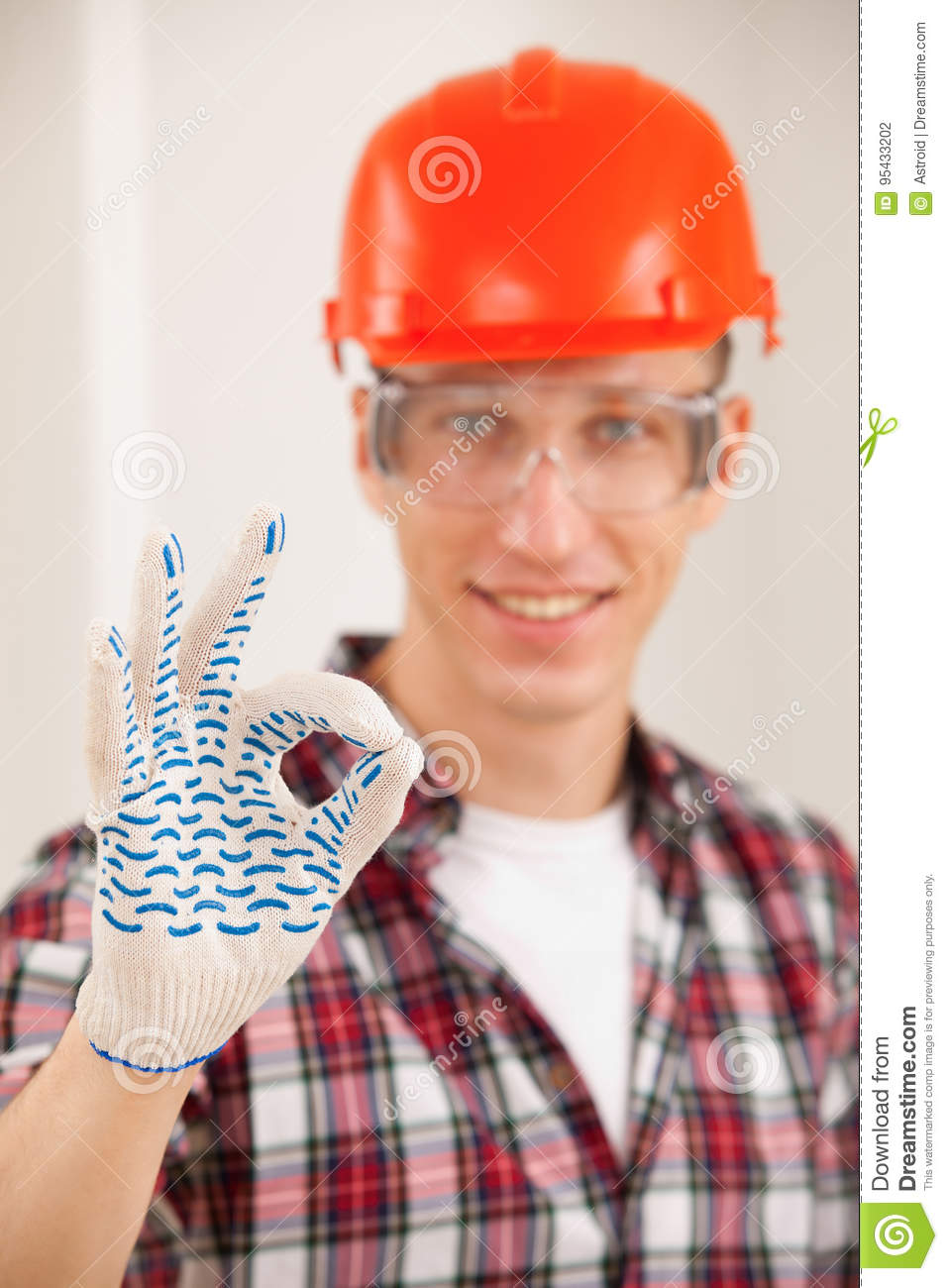 Repairman making a perfect gesture with his gloved hand