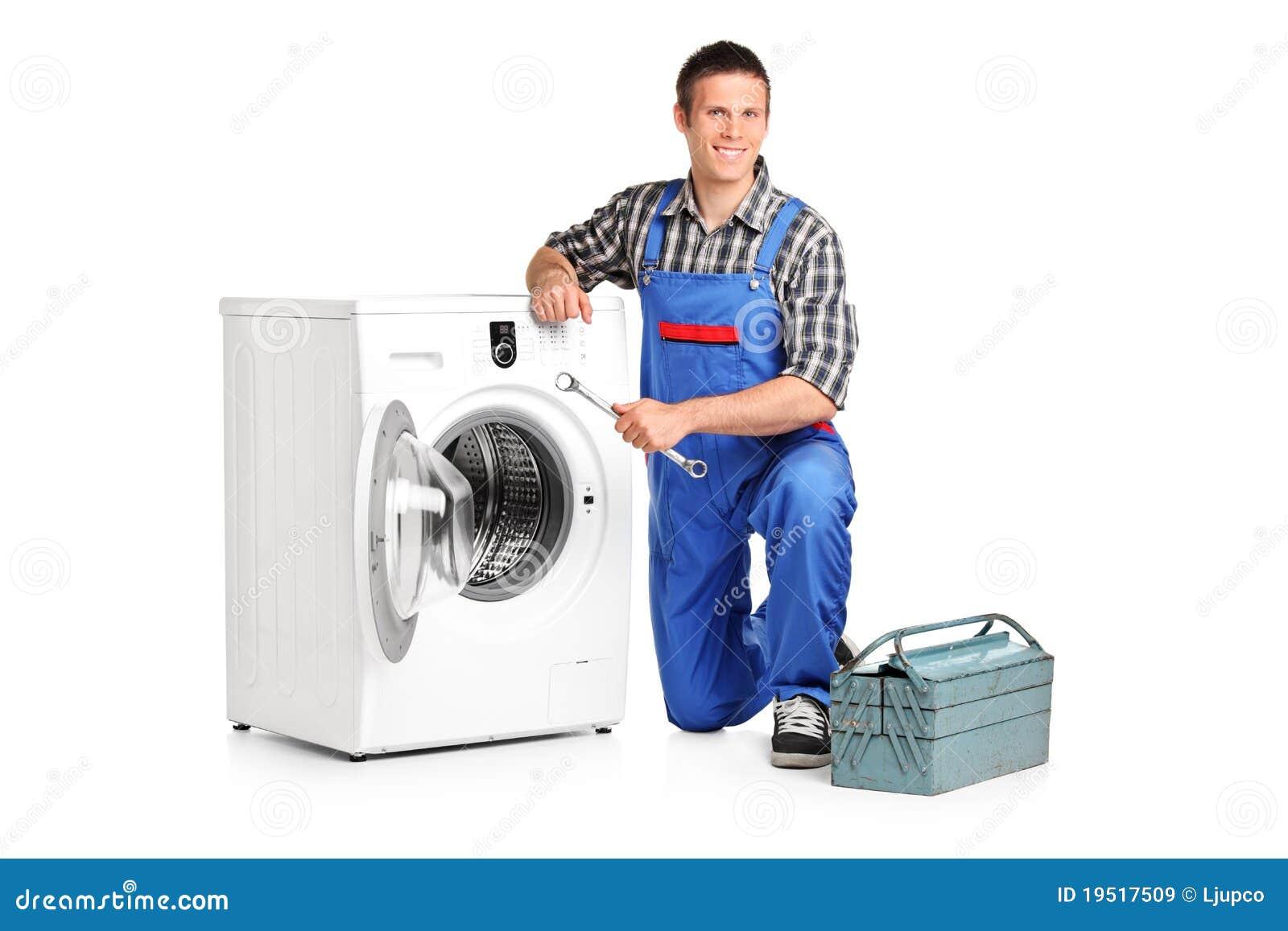 Repairman posing next to a washing machine