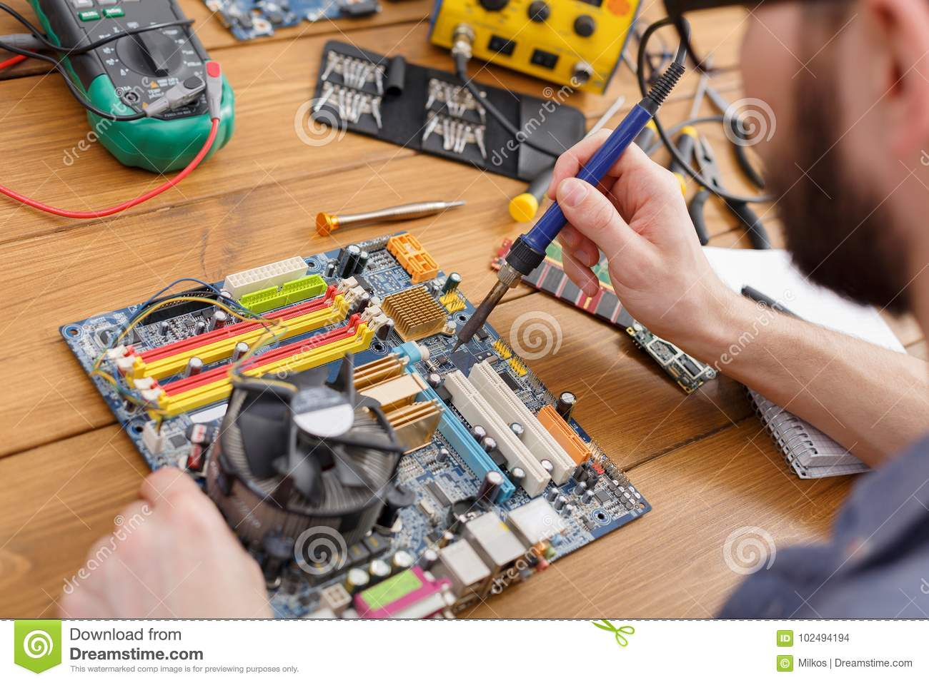 Repairman Soldering Computer Circuit In Workshop Stock Photo Image Technician Repairing Electronic Board With Iron