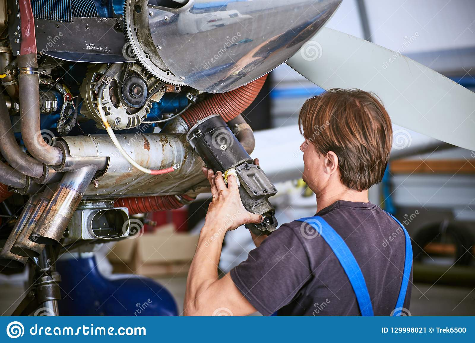 Replacing The Defective Parts Of Aircraft Service Worker Stock An