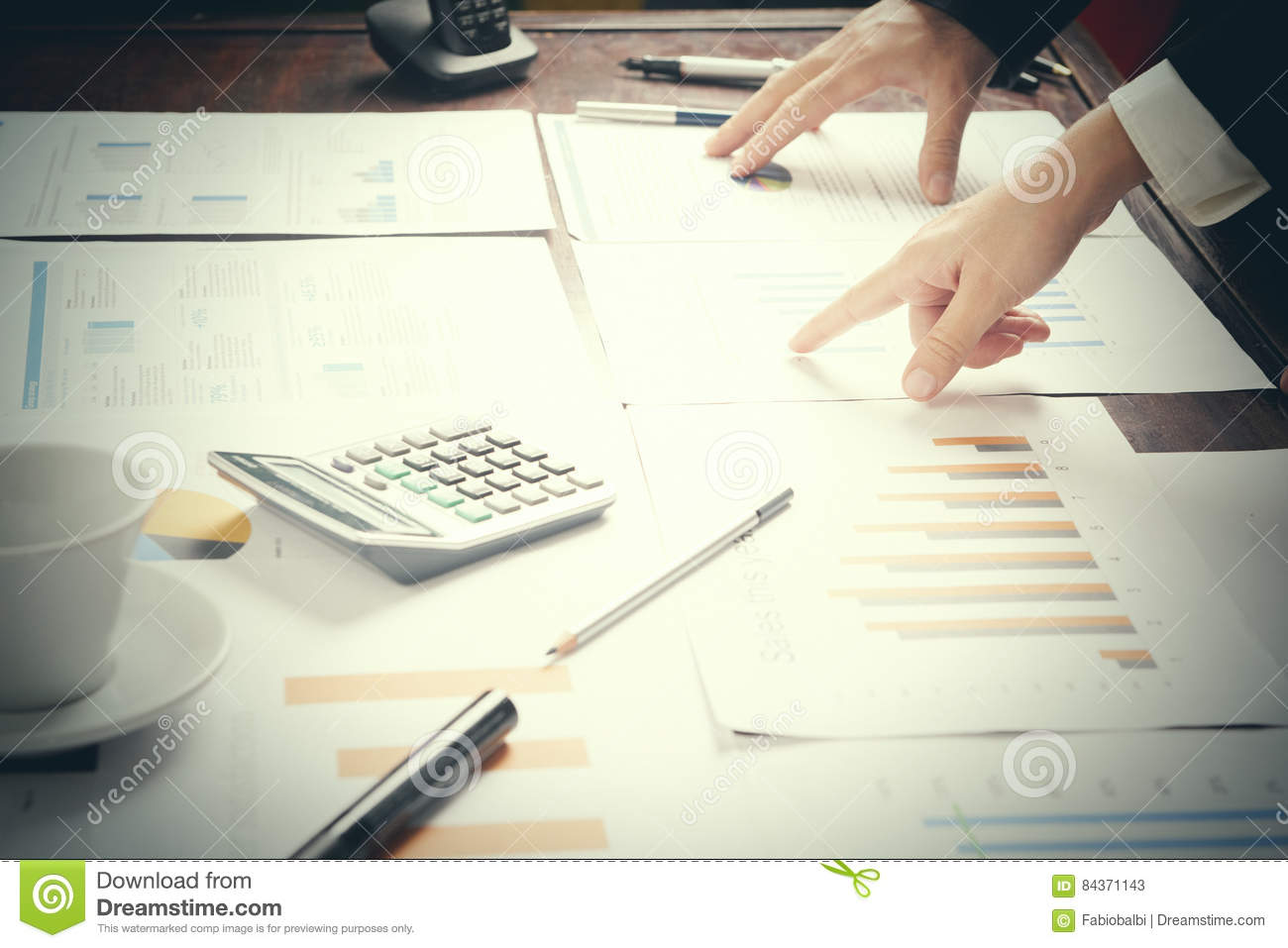 Report. Business man in office with charts