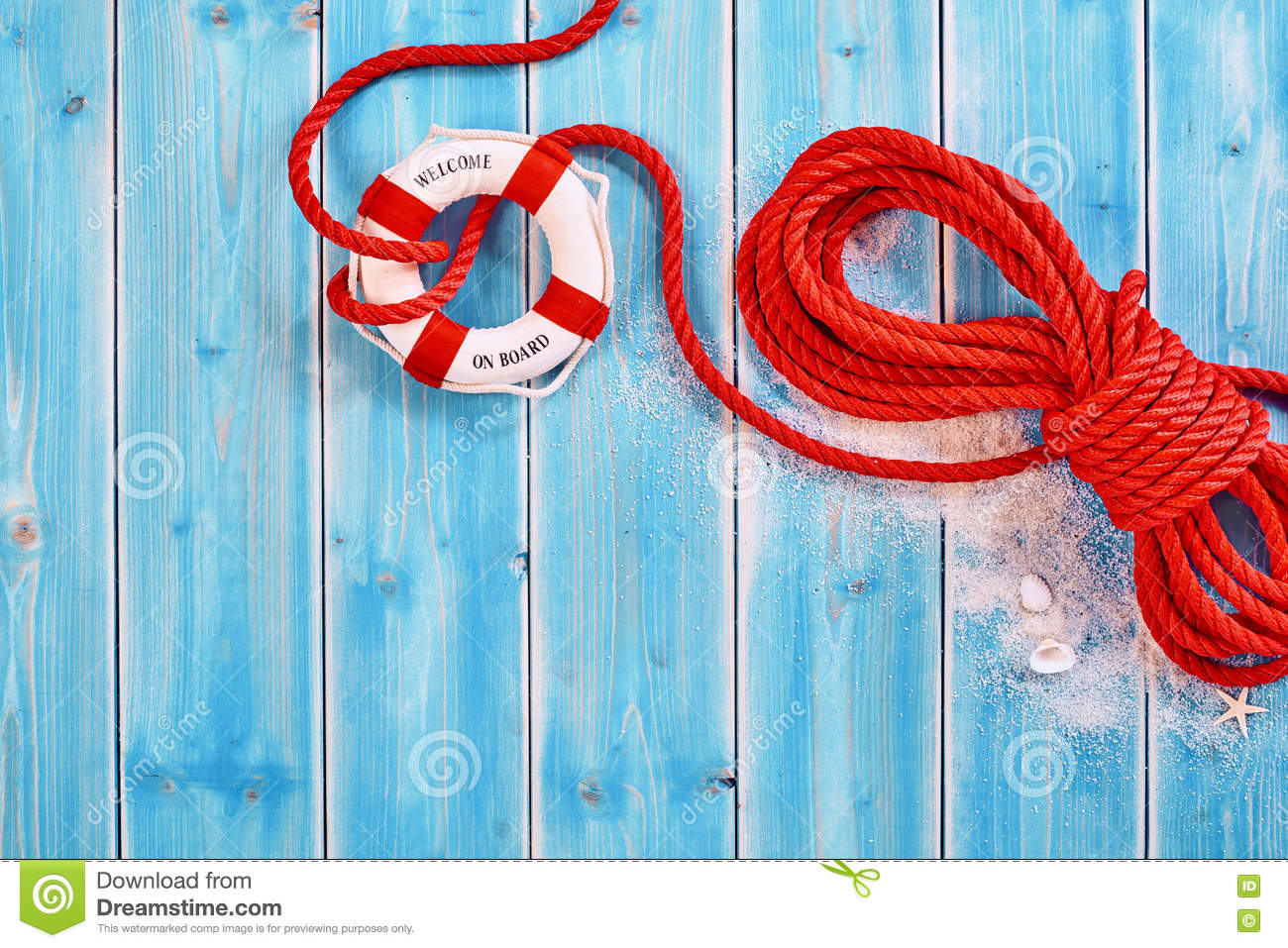 Rescue rope with life preserver over blue