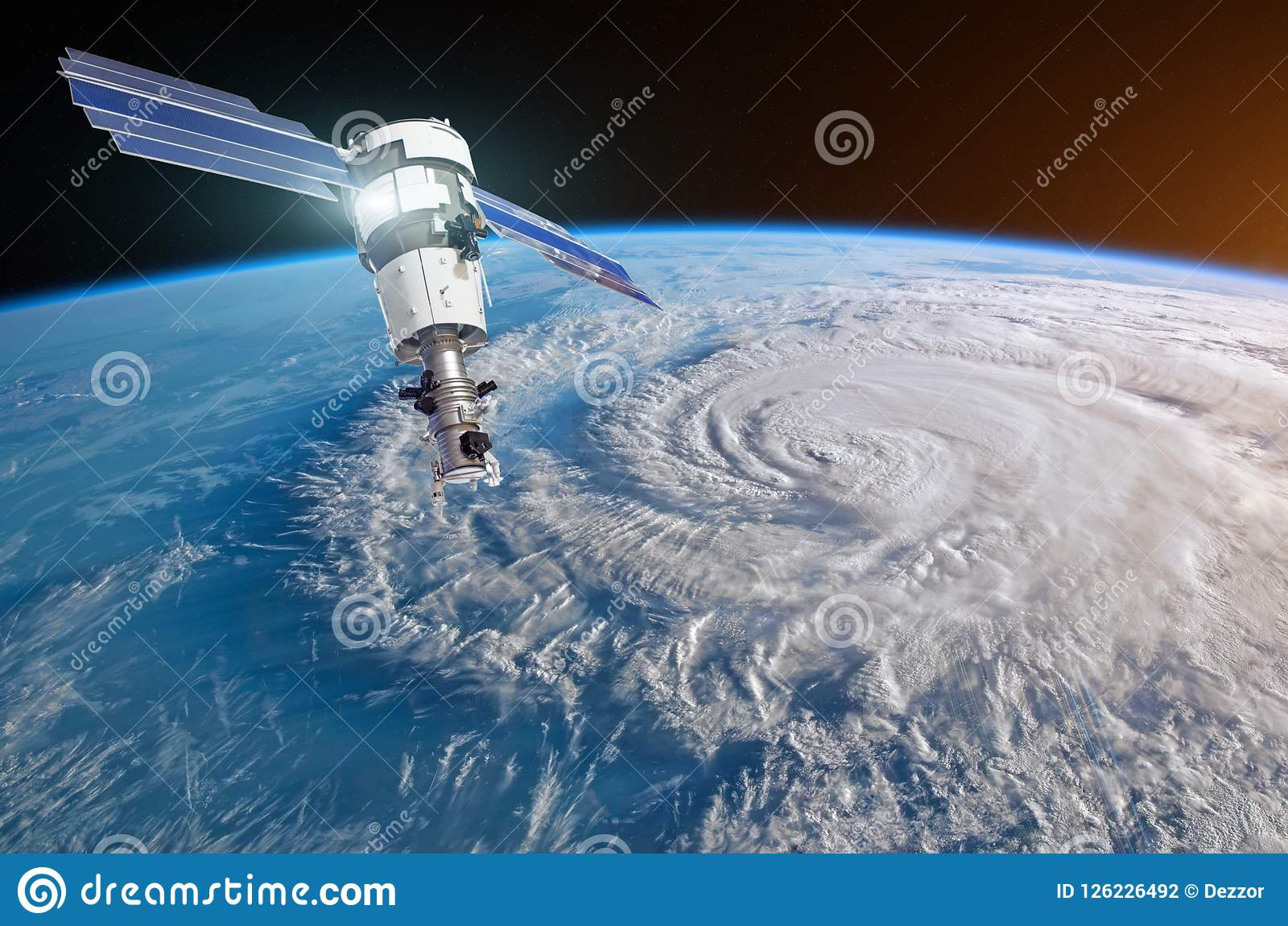 Research, probing, monitoring hurricane Florence raging on the coast. Satellite above the Earth makes measurements of the weather