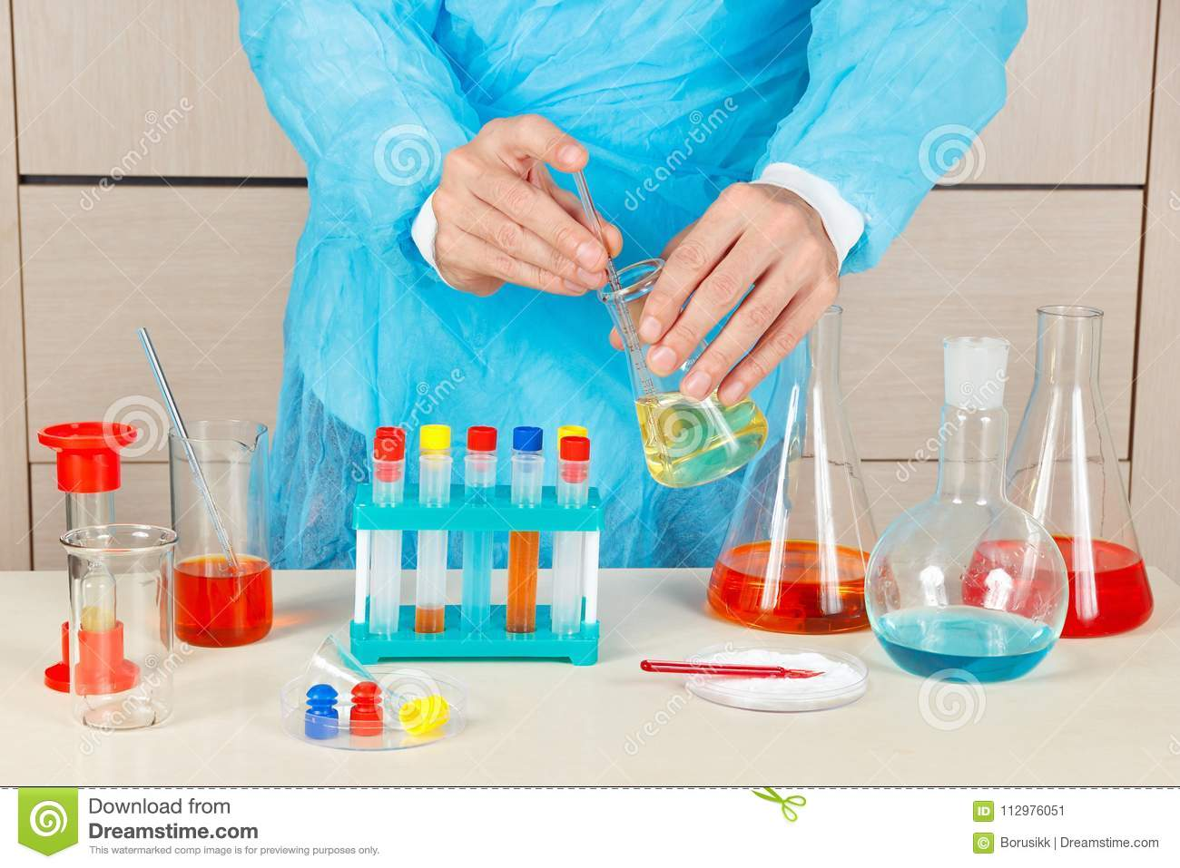 Researcher doing chemical experiments in laboratory
