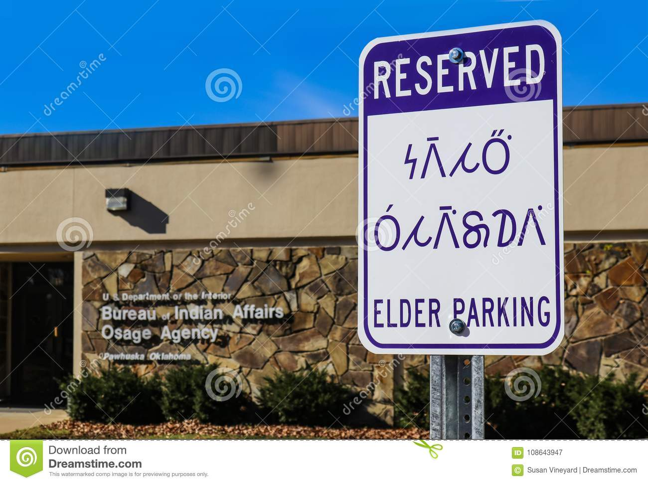 Reserved elder parking sign in english and the osage indian