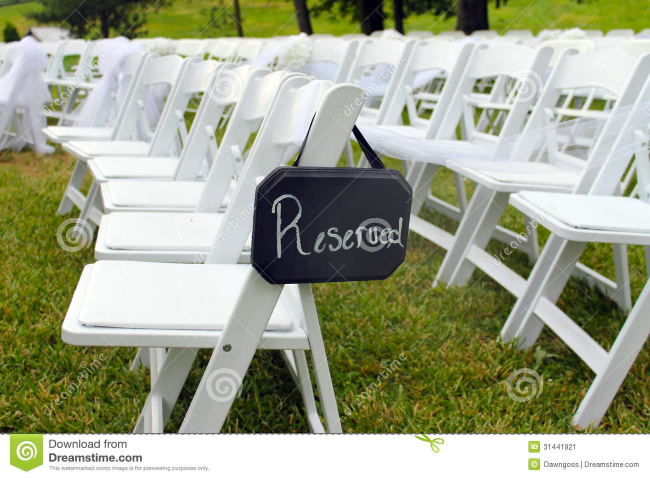 White Chairs At A Wedding Indoor Stock Photo: Reserved Sign At Outdoor Wedding Stock Image