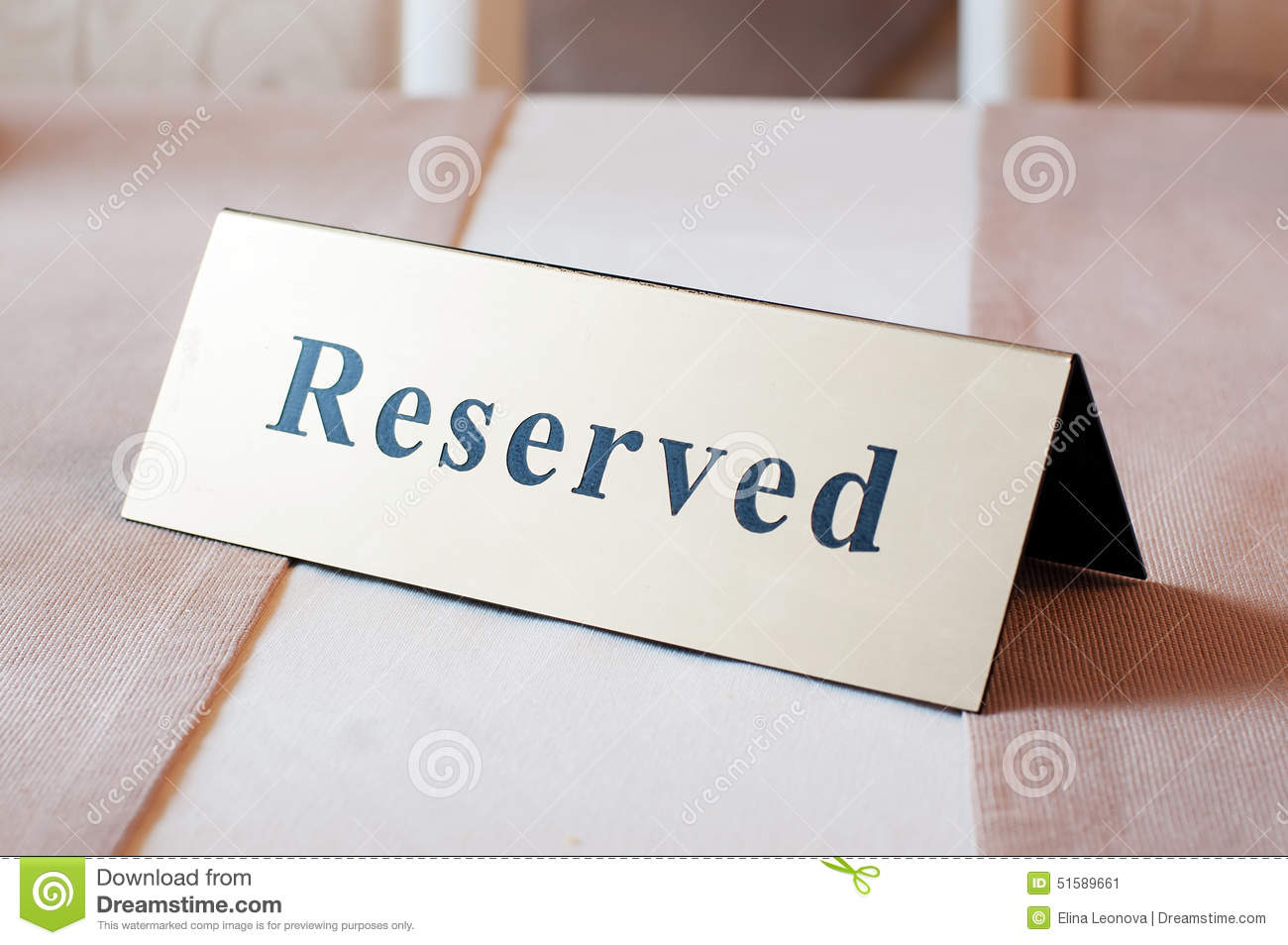 Reserved sign reservation on table beige color stock for Table 52 reservations