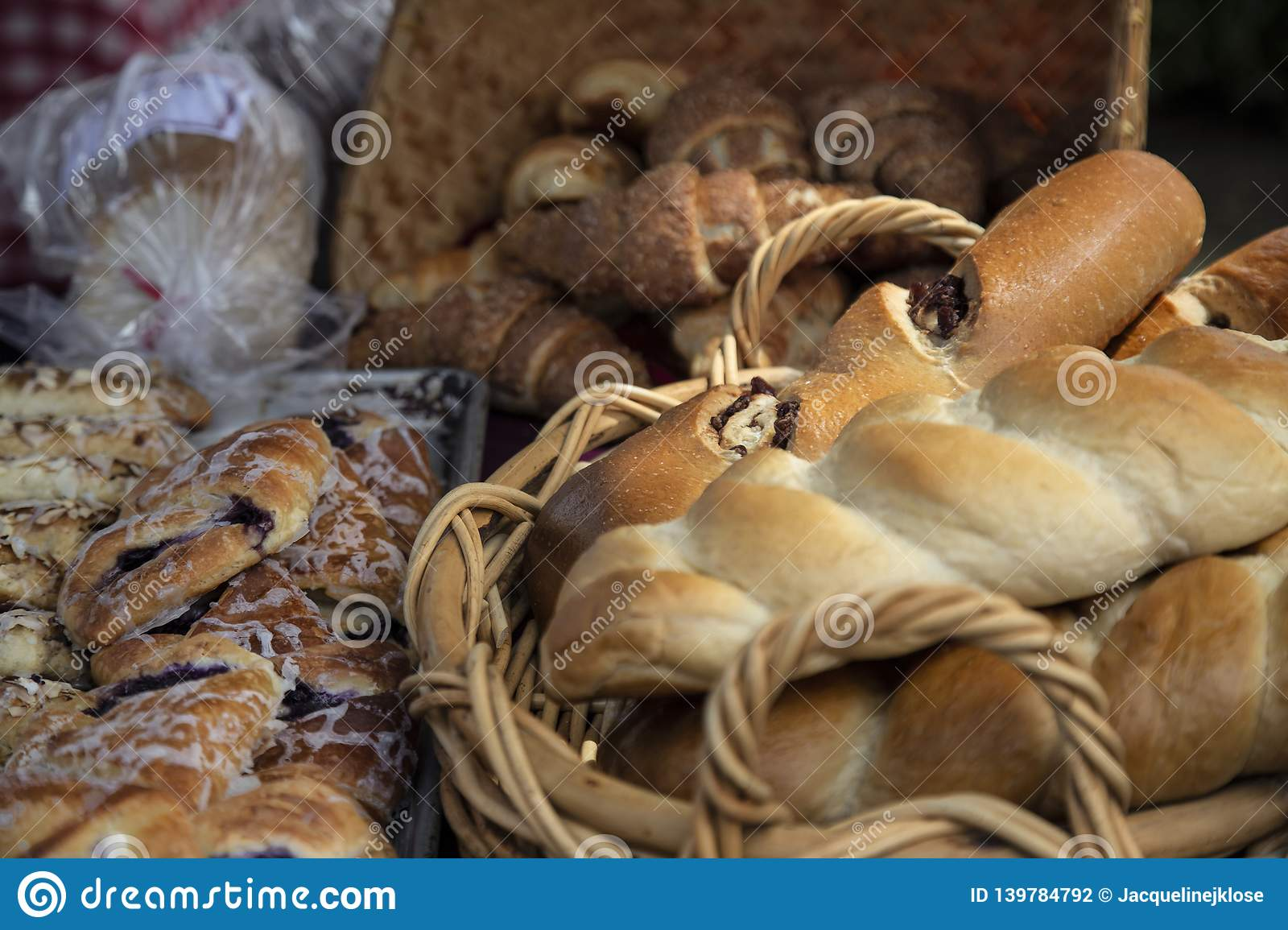 Reshly Baked Organic Loaves of Bread in Baskets, Pastries on Bake Pans