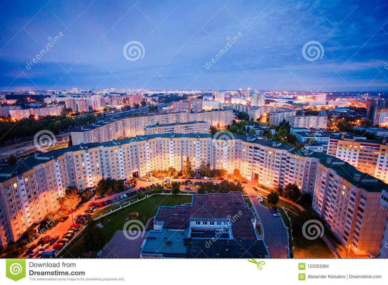 Residential area view at night. Blocks of flats and city lights