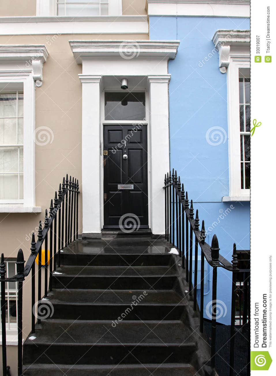 Red entrance door in front of residential house stock photo - Residential Door Royalty Free Stock Photography Image