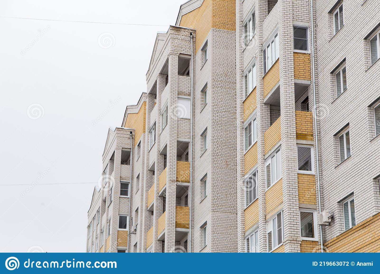 Residential High-rise Building With Yellow Balconies ...