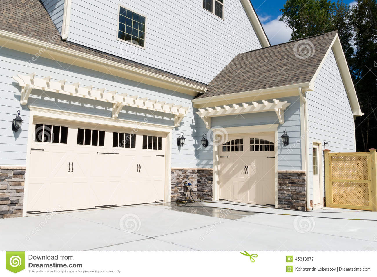 residential house three car garage doors stock photo