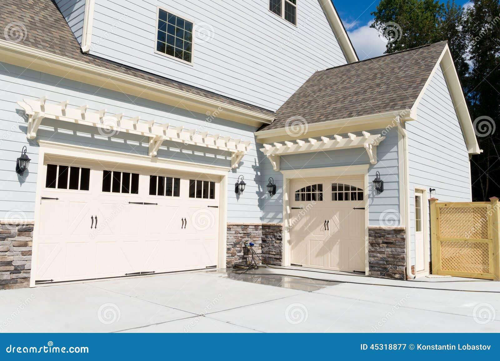 Residential house three car garage doors stock photo for Three door garage