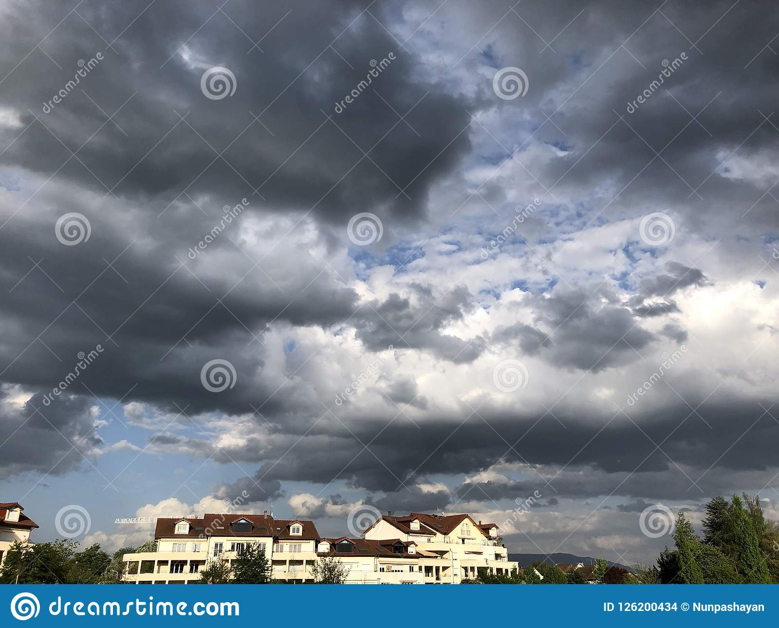 Thunderclouds over the houses in Ferney-Volter
