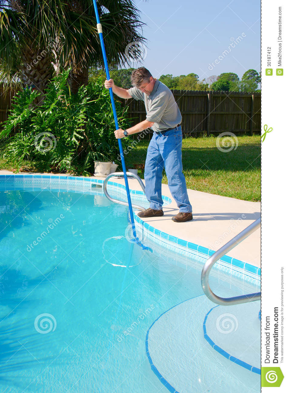 Residential pool cleaning service man working stock photo for Pool maintenance