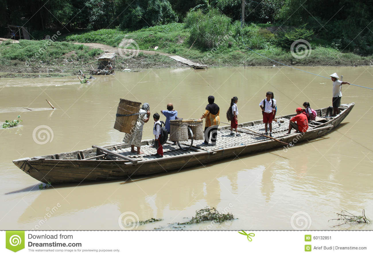 Residents Crossing The River By Boat Solo Canoe As A Means